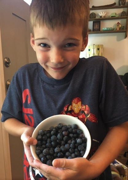 Finn with blueberries