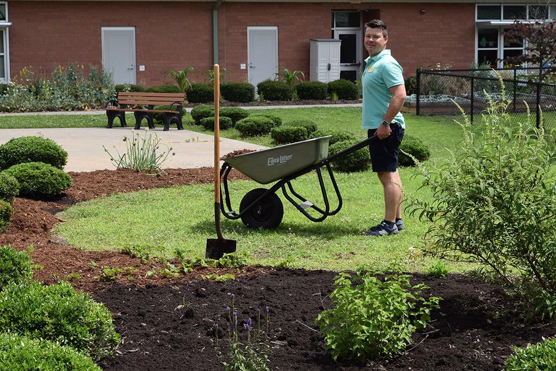 adding soil3 compost to rain and pollinator garden