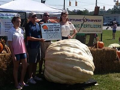 Yadkin Valley Pumpkin Festival weigh-off winners with 1328 lb pumpkin.jpg