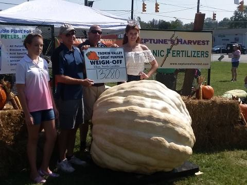 Yadkin Valley Pumpkin Festival weigh-off winners with 1328 lb pumpkin.jpg