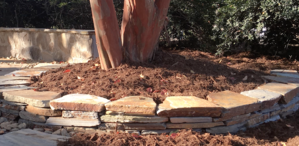 How To Build a Dry Stack Stone Wall and Backfill with Soil [Video]