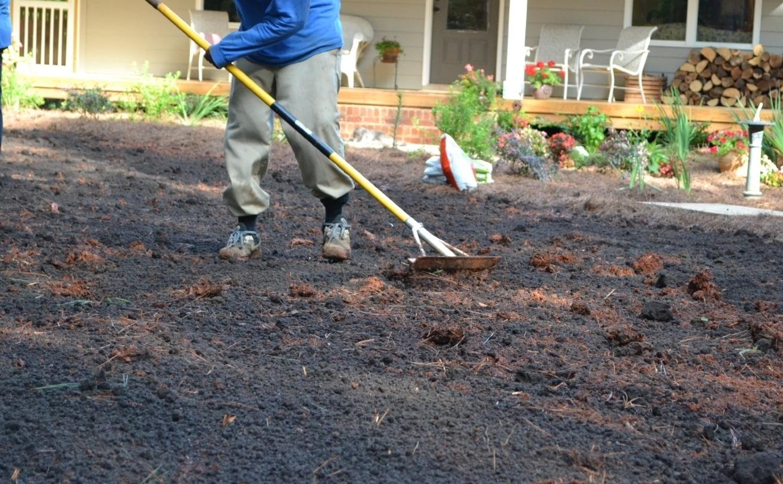 raking_compost_into_soil.jpg